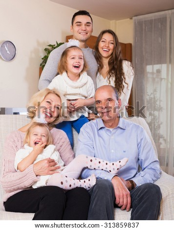 happy family with grand children posing indoors  - stock photo