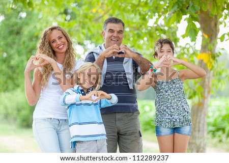 Happy Family with Heart Shaped Hands - stock photo