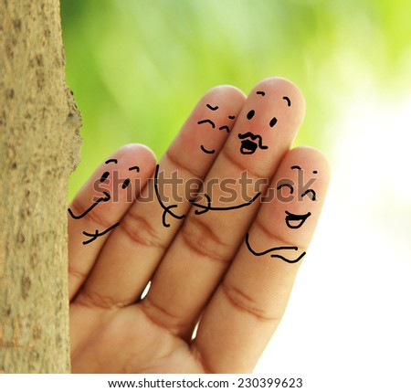 happy family with human finger concept - stock photo