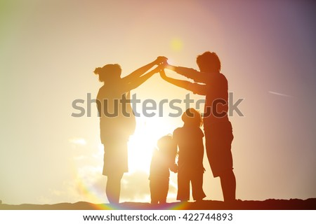 Happy family with kids and pregnant mother together at sunset - stock photo