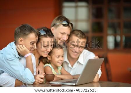 happy family  with laptop - stock photo