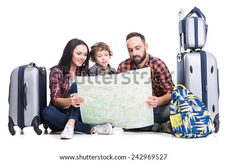 Happy family with luggage and map are ready to travel. Isolated on white background. - stock photo