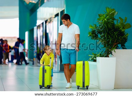 happy family with luggage ready for summer vacation, in airport - stock photo
