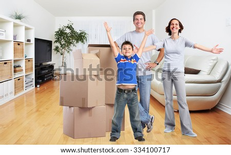 Happy family with moving boxes in new modern apartment. - stock photo