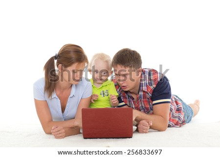 Happy family with notebook on a white background. - stock photo