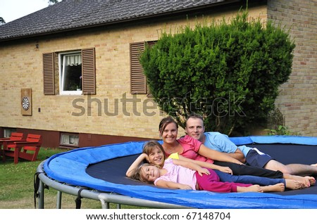 Happy family with own villa - stock photo