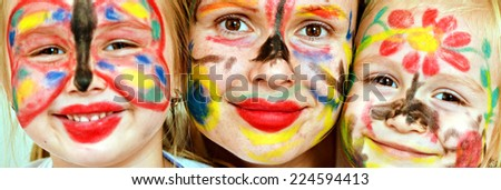 happy family with painted faces - stock photo