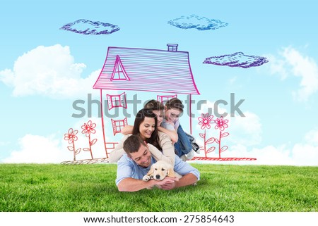 Happy family with puppy against blue sky over green field - stock photo