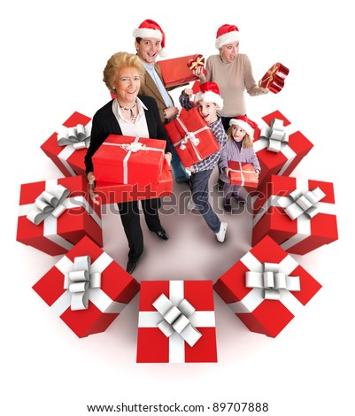 Happy family with Santa?s hats surrounded by gifts - stock photo