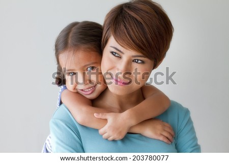 happy family with smiling, positive daughter hugging her mother - stock photo