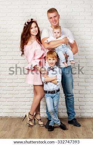 Happy family with two sons in full growth - stock photo