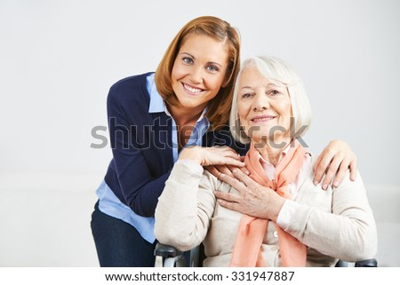 Happy family with woman and senior woman at home - stock photo