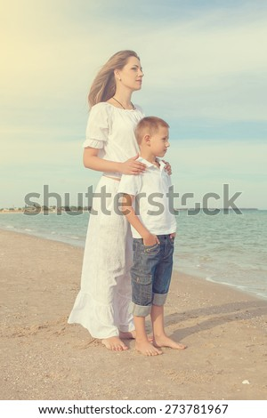 Happy family. Young happy beautiful  mother and her son on the beach. Positive human emotions, feelings, emotions. - stock photo