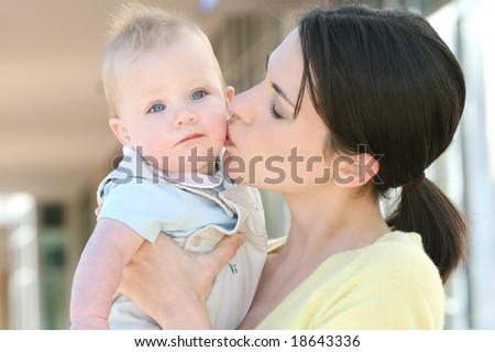 Happy family - young mother with her adorable baby boy son, suitable for a variety of family, parenting backgrounds - stock photo