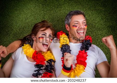 happy fantatic soccer football couple - stock photo