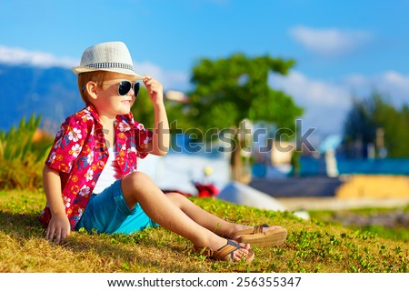 happy fashionable kid on summer meadow - stock photo
