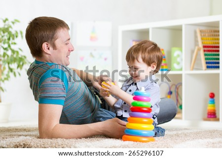 happy father and child son playing together indoor at home - stock photo