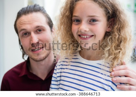 Happy father and daughter enjoying in shopping mall - stock photo
