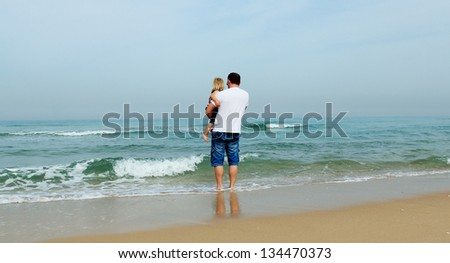 Happy father and his adorable little daughter - stock photo