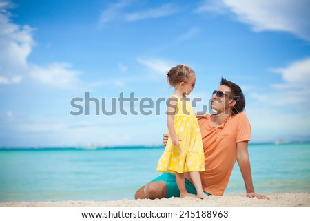 Happy father and his adorable little daughter at tropical beach - stock photo