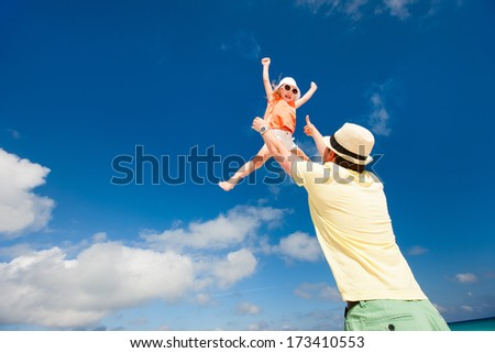 Happy father and his adorable little daughter having fun together  - stock photo