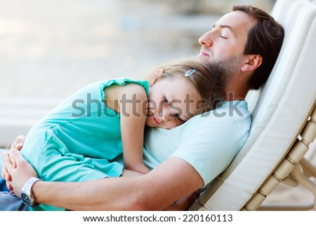 Happy father and his adorable little daughter outdoors - stock photo
