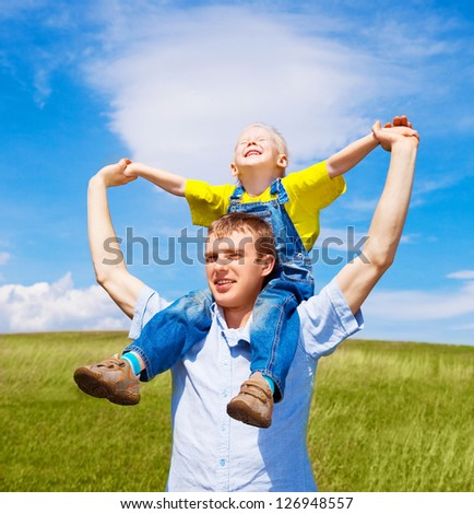 happy father and his son outdoor on a summer day - stock photo