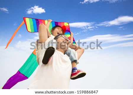 happy father and little girl with colorful kite - stock photo