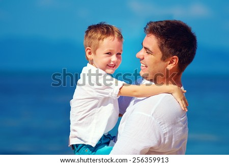 happy father and son embracing, family relationship - stock photo
