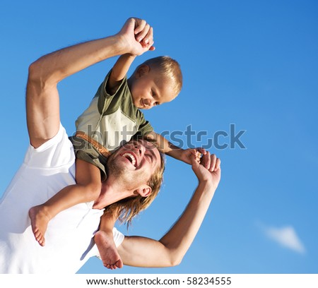Happy Father and Son outdoor - stock photo