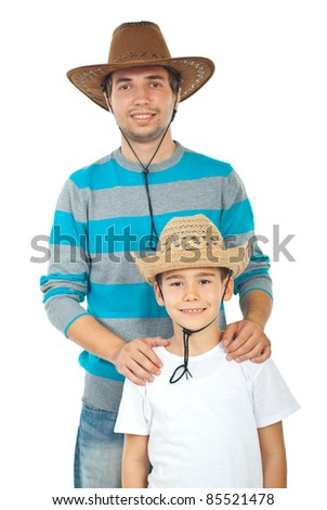 Happy father and son with cowboy hats isolated on white background - stock photo