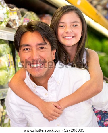 Happy father carrying her daughter at the back - stock photo
