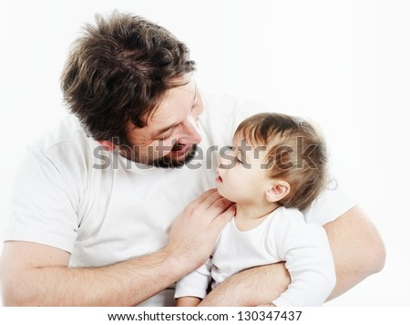 Happy father holding a smiling cute baby - stock photo