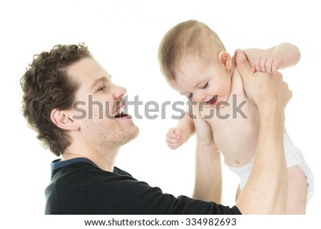happy father holding baby boy in his hands isolated on white - stock photo