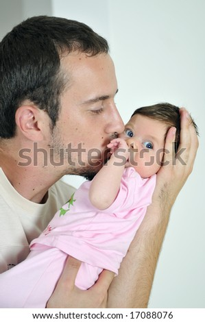 happy father holding cute little baby in hand - stock photo