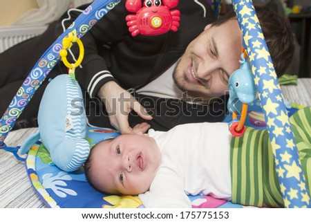 Happy father is holding his newborn baby - stock photo