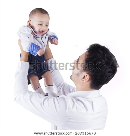 Happy father playing in the studio with his baby and lift up the baby, isolated on white - stock photo