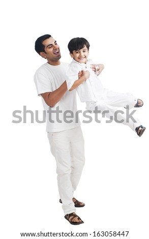 Happy father playing with his son - stock photo