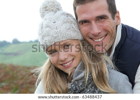Happy father with daughter in fall season - stock photo