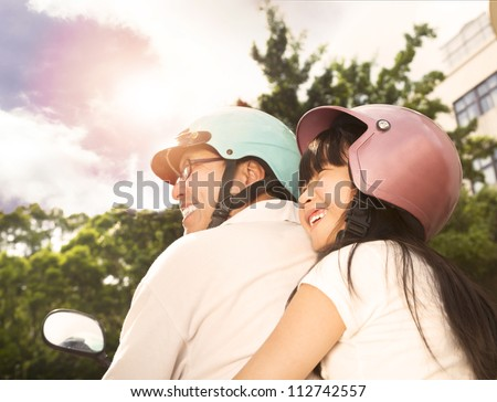 happy father with daughter on the bike - stock photo
