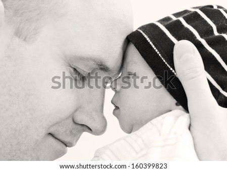 happy father with newborn son on a white background - stock photo