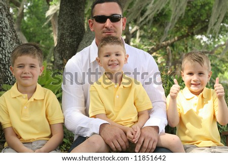 Happy Father with three sons - stock photo