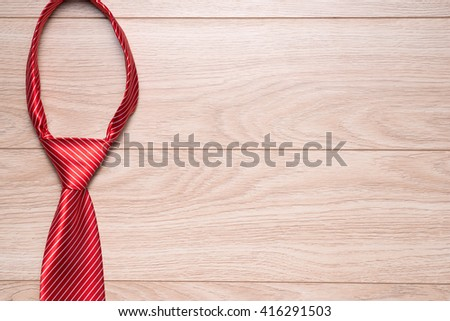 Happy Fathers Day gift tag with red striped necktie on rustic wood background - stock photo