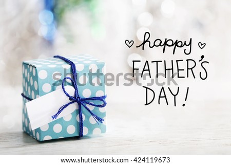 Happy Fathers Day message with small handmade gift box  - stock photo