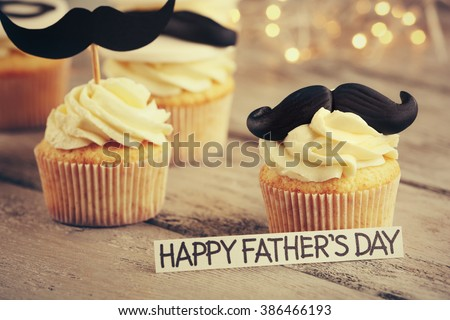 Happy fathers day special cupcakes on wooden table - stock photo