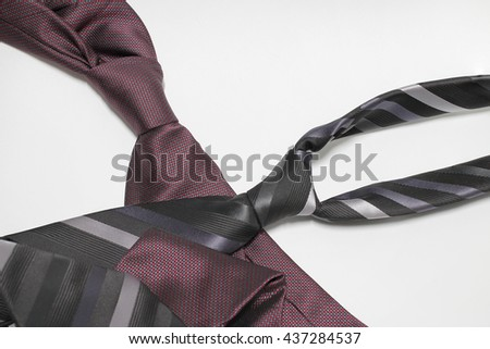 Happy Fathers Day with red, gray and black striped necktie on white background - stock photo
