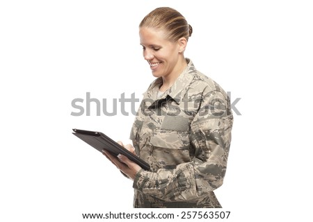 Happy female airman with digital tablet against white background - stock photo