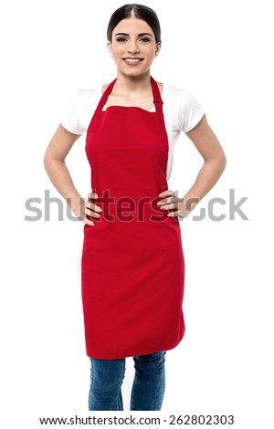 Happy female chef with hands on her waist - stock photo
