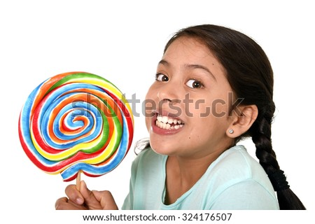 happy female child holding big lollipop candy in freak crazy funny face expression in sugar addiction and kid love for sweet concept isolated on white background - stock photo
