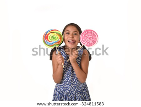 happy female child wearing dress holding two big lollipop in crazy funny face expression in sugar addiction and kid love for sweet candy concept isolated on white background - stock photo